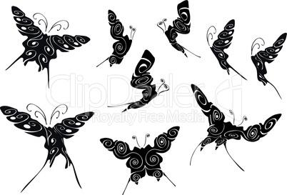 Florale schwarze Schmetterlingsumrisse