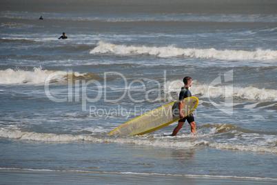 Surfers in Galveston, Texas