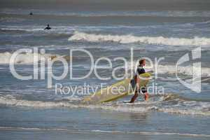 Surfers in Galveston, Texas