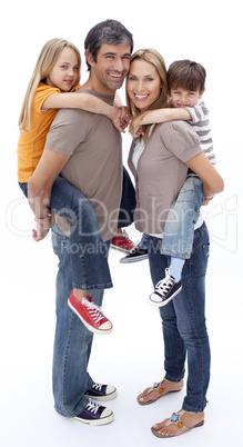 Family giving children piggyback ride