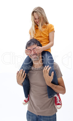 Dad giving girl piggyback ride with closed eyes