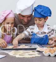 Portrait of father and children baking