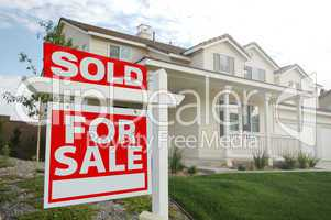 Sold Home For Sale Sign and New Home