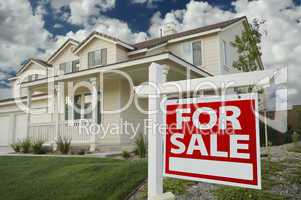 Home For Sale Real Estate Sign and New House.
