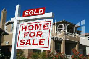 Sold Home For Sale Sign & New House