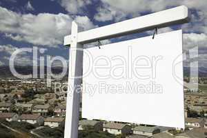 Blank Real Estate Sign Over Elevated Housing Community View