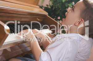 Children Playing the Piano
