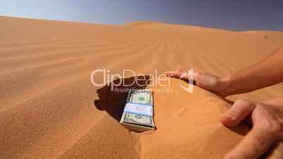 Gelscheine im Sand vergraben
