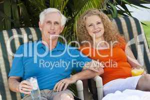 Senior Man and Woman Couple Enjoying Retirement Drinks on Vacati