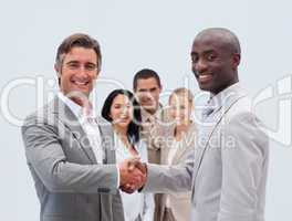 Caucasian and Afro-American businessmen shaking hands