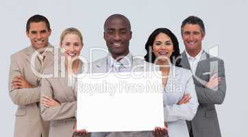 Afro-American businessman holding a white card with his team