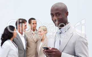 Afro-American businessman sending a text
