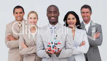 Business team holding a molecule model. Scince and business conc