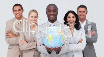 Afro-American businessman holding a terrestrial globe with his t