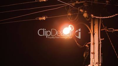 Rural street lamp lighting with passing insects