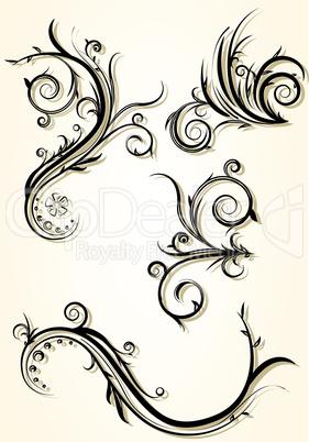 set of four decorative floral elements