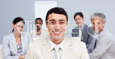 Smiling businessman leading his team in a meeting