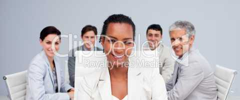 Afro-American businesswoman smiling in a meeting