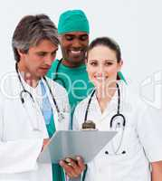 Portrait of medical team taking notes