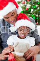 Happy father and daughter playing with Christmas gifts