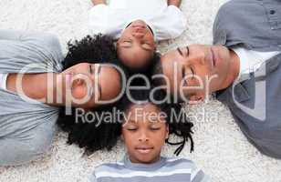 Afro-American young family lying on floor