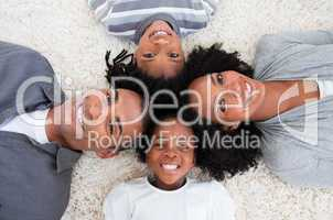 Afro-American family on floor with heads together