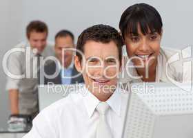 Afro-American businesswoman working with a businessman in the of