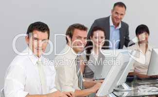 Multi-ethnic business team working with computers in an office