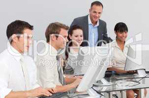 Multi-ethnic business people and manager working with computers