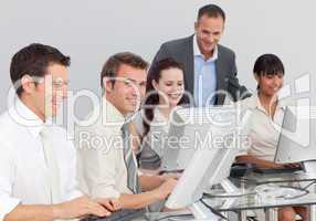 Multi-ethnic business people working with computers in an office