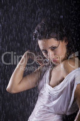 young girl under rain