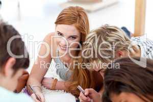 Portrait of a teen girl doing homework