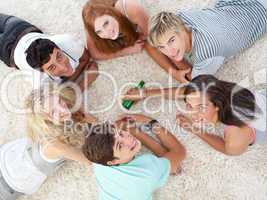 Group of teenagers playing spin the bottle