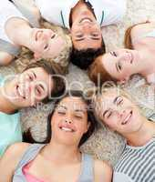 Teenagers with their heads together smiling