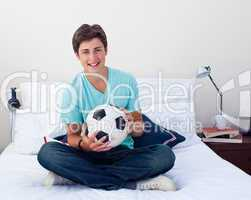 Teen guy holding a soccer ball