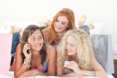 Happy teen girls after shopping clothes
