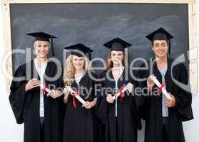 Group of adolescents celebrating after Graduation