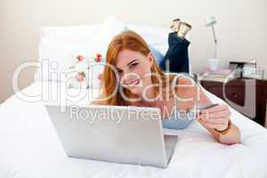 Teen girl using a laptop and shopping online