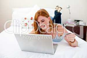 Young girl using a laptop and shopping online