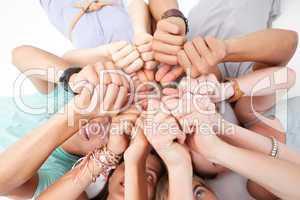 Teens lying on floor with thumbs up