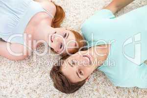Teenagers lying on floor