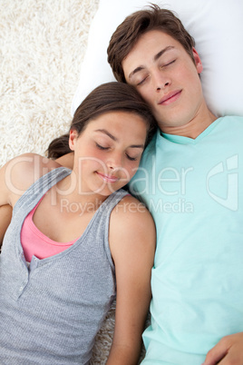 Teen lovers lying on the floor