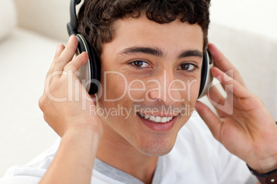 Teen guy listening to music