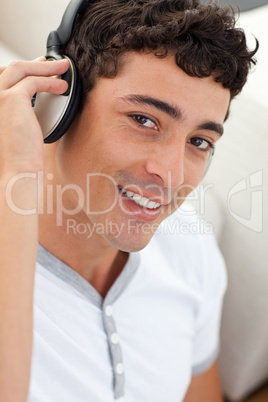 Portrait of teen guy listening to music