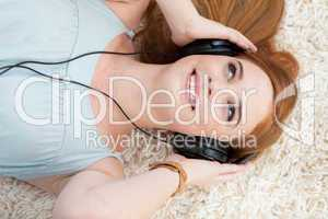 Beautiful teen girl listening to music