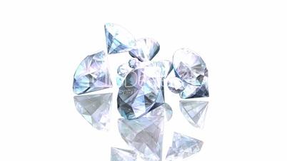 Diamonds falling on a white background HD1080