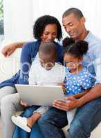 Happy family using a laptop