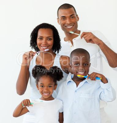 Afro-american family brushing their teeth