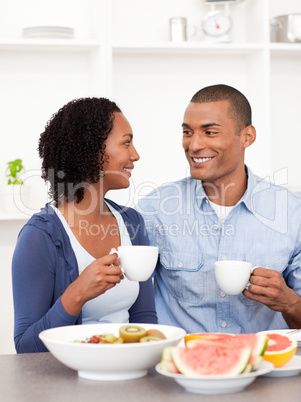 Smiling lovers having healthy breakfast