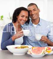 Portrait of an Afro-american couple having breakfast